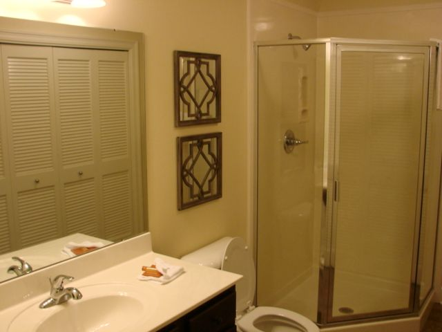 Hallway bath with standup shower, also has full size washer and dryer