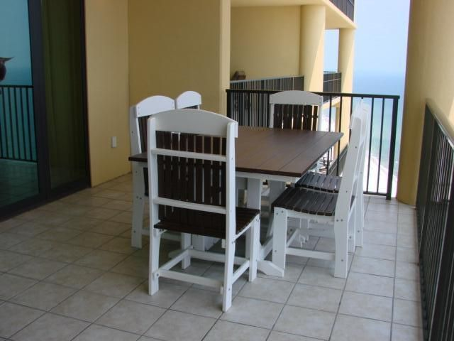 Balcony Furniture includes table seating for six plus one chase lounger chair