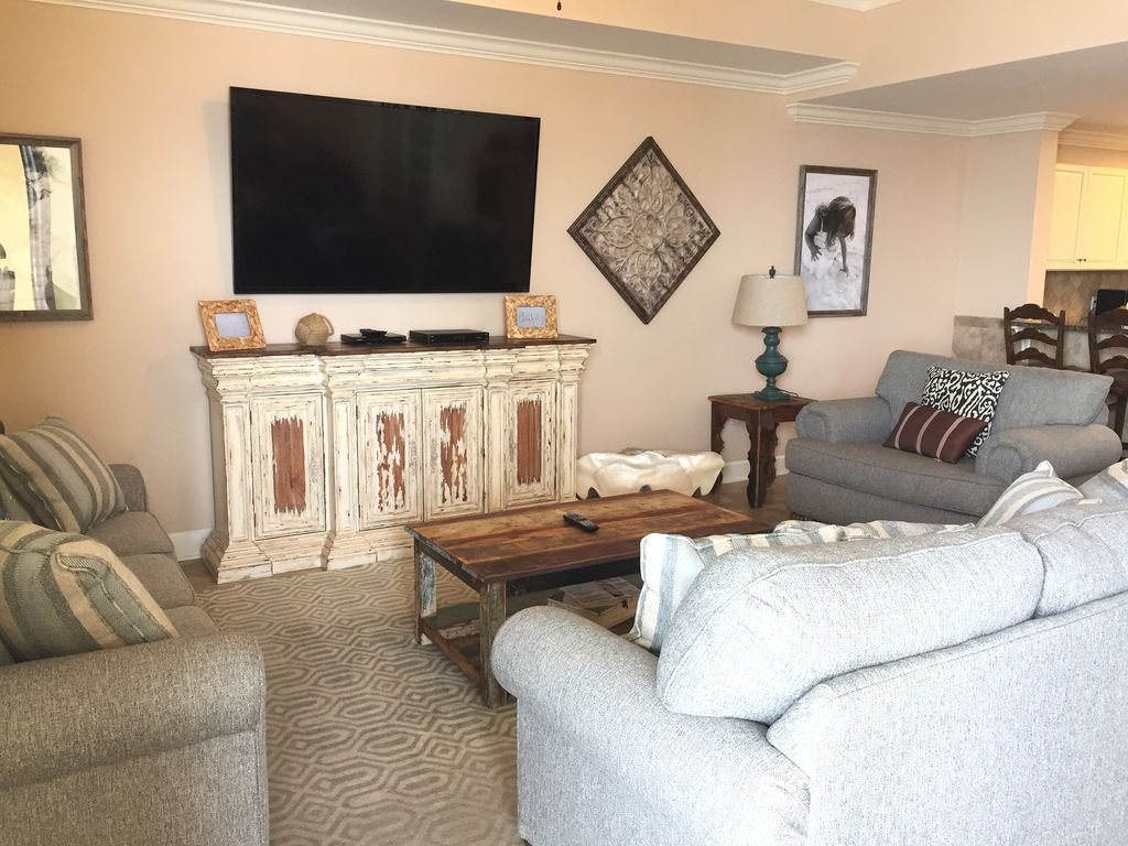 Living Room with plenty of seating to watch 70 inch Smart Tv