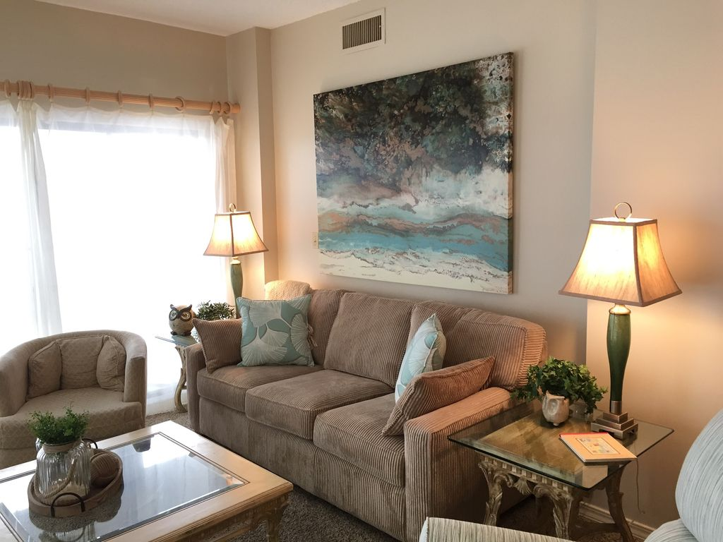 Spacious living room with sofa, 2 recliners, and swivel chair
