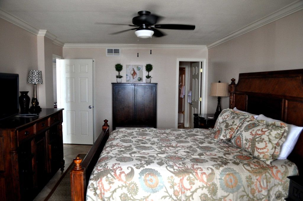 Romar Tower - Master bedroom with dresser and TV