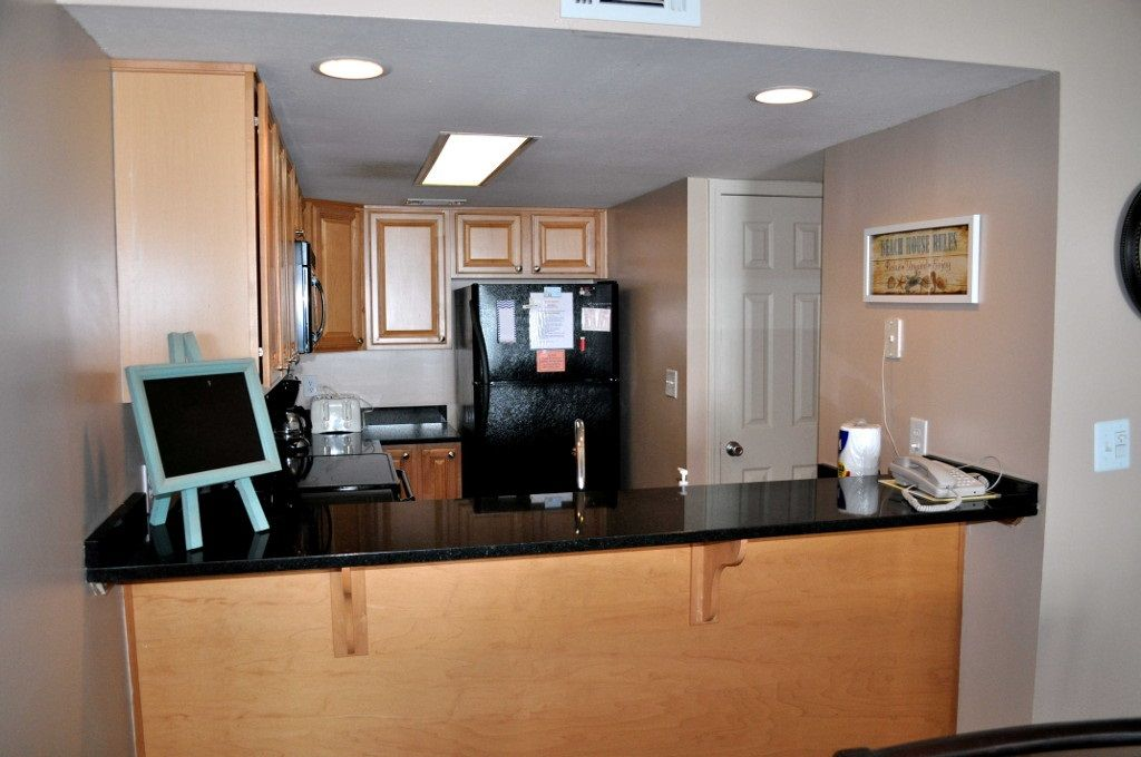 Romar Tower- View of kitchen from livingroom