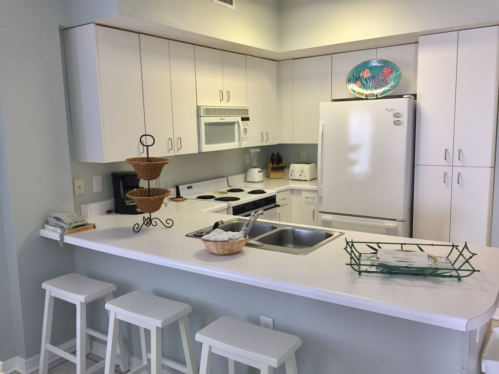 Kitchen with three barstools at the counter