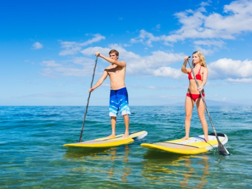 Man and woman paddleb boarding in the ocean