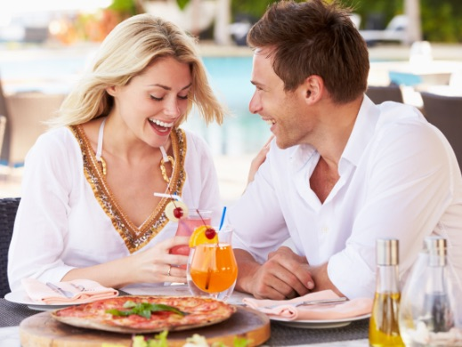 Man and woman eating outside at restaurant