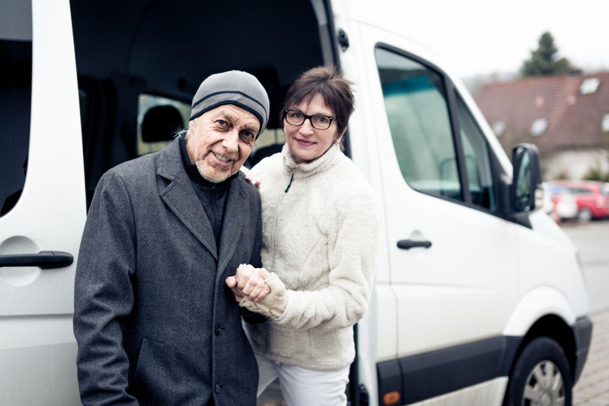 Driver assisting Senior Citizen aboard shuttle