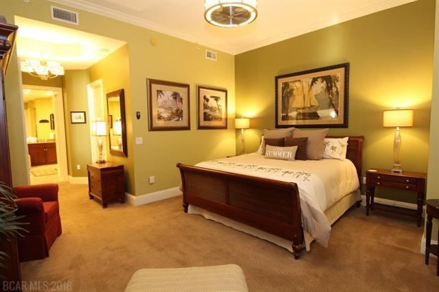 Master Bedroom with pictures on the wall