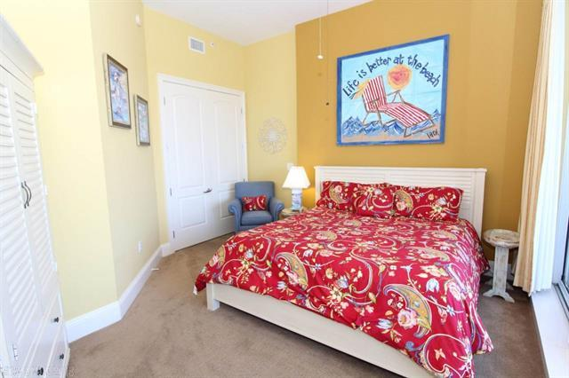 Bedroom with a red floral comforter on the bed