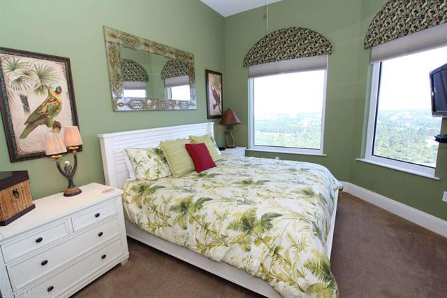 Bedroom with green floral comforter on the bed