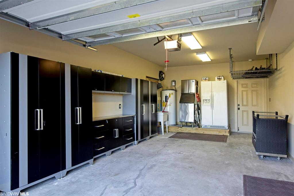 One of Two Garages with storage and Ice Maker