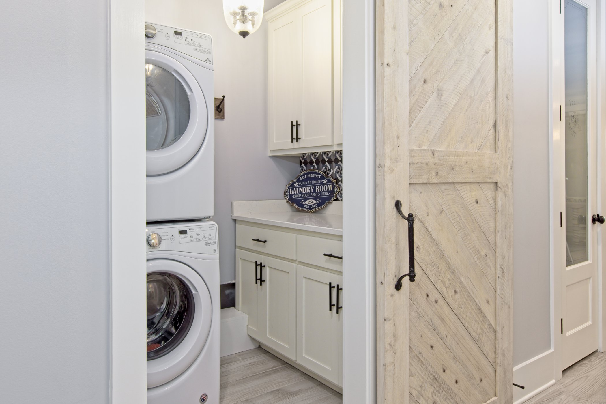 Laundry Room with Sliding Barn Style Door