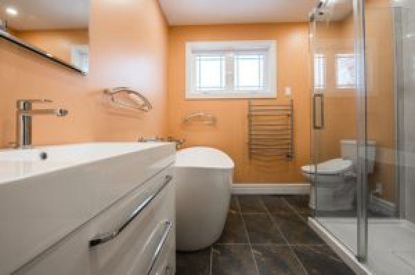 image of a narrow bathroom with peach colored walls