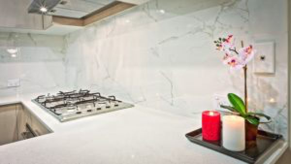 image of a white marble counter top and a stove