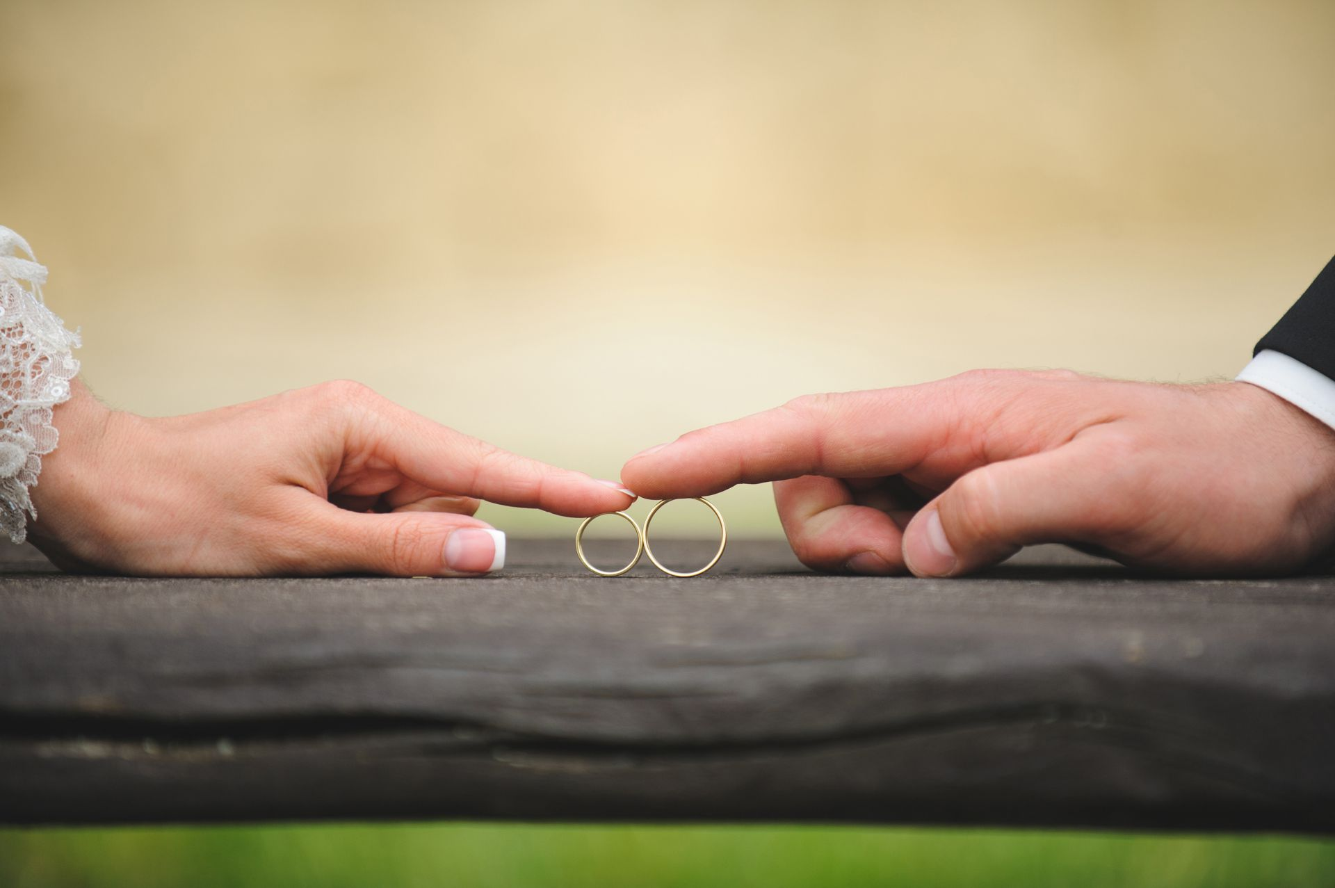 An Image of a bride's hand and groom's hand touching each other