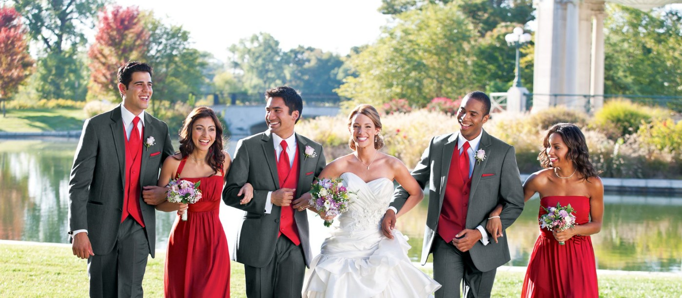 An image of a bride and groom walking with bridesmaids and groomsmen