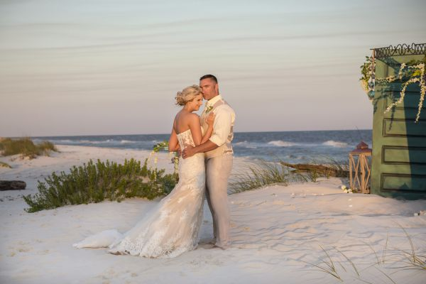 An image of a bride and groom on a beach