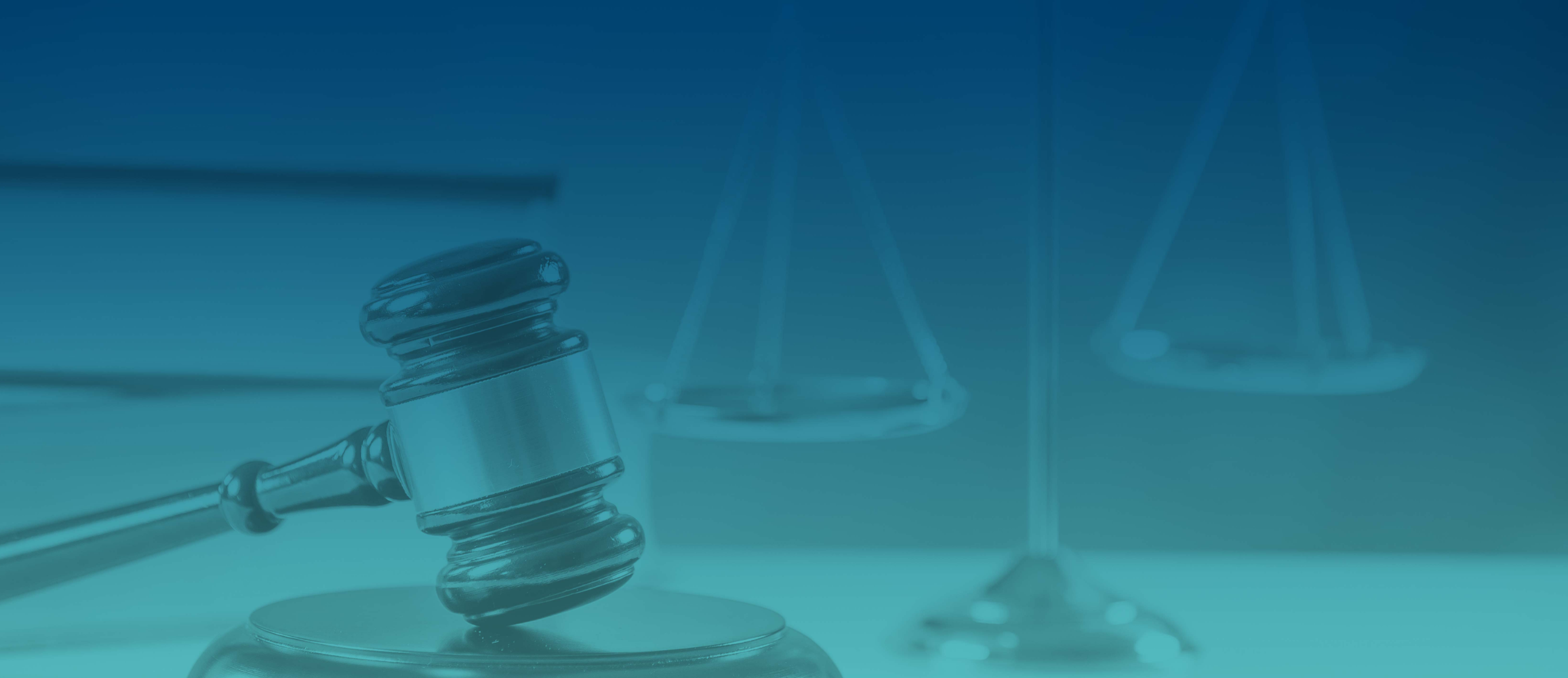 Courtroom gavel. Image has aqua tint overlaid.