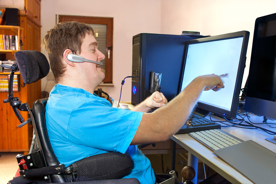 man with physical disability using internet