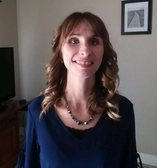 Image of Stephanie Bolinger smiling in blue shirt
