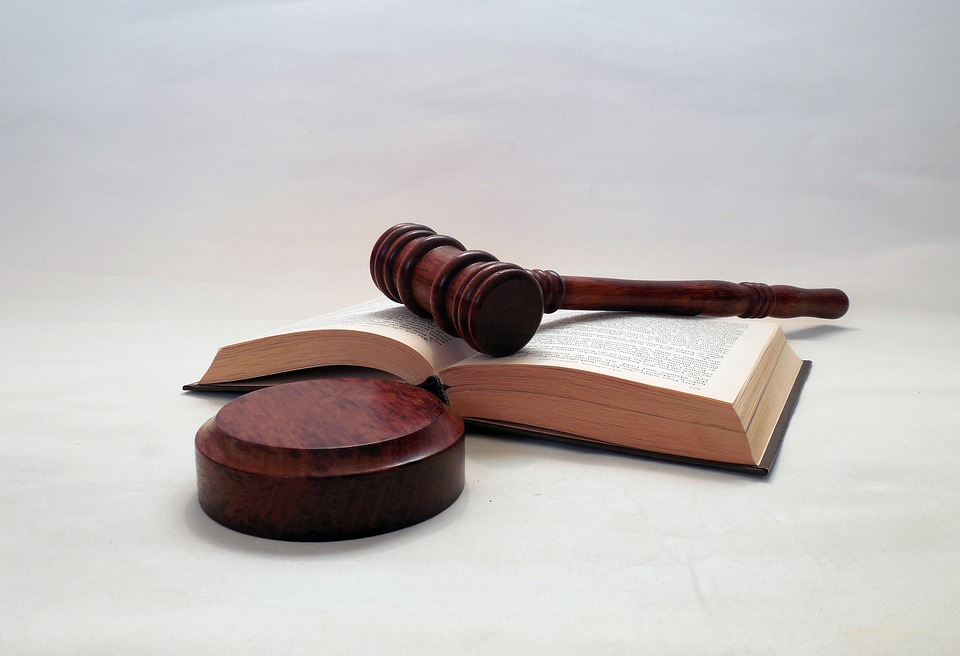 Gavel and book lying on a table