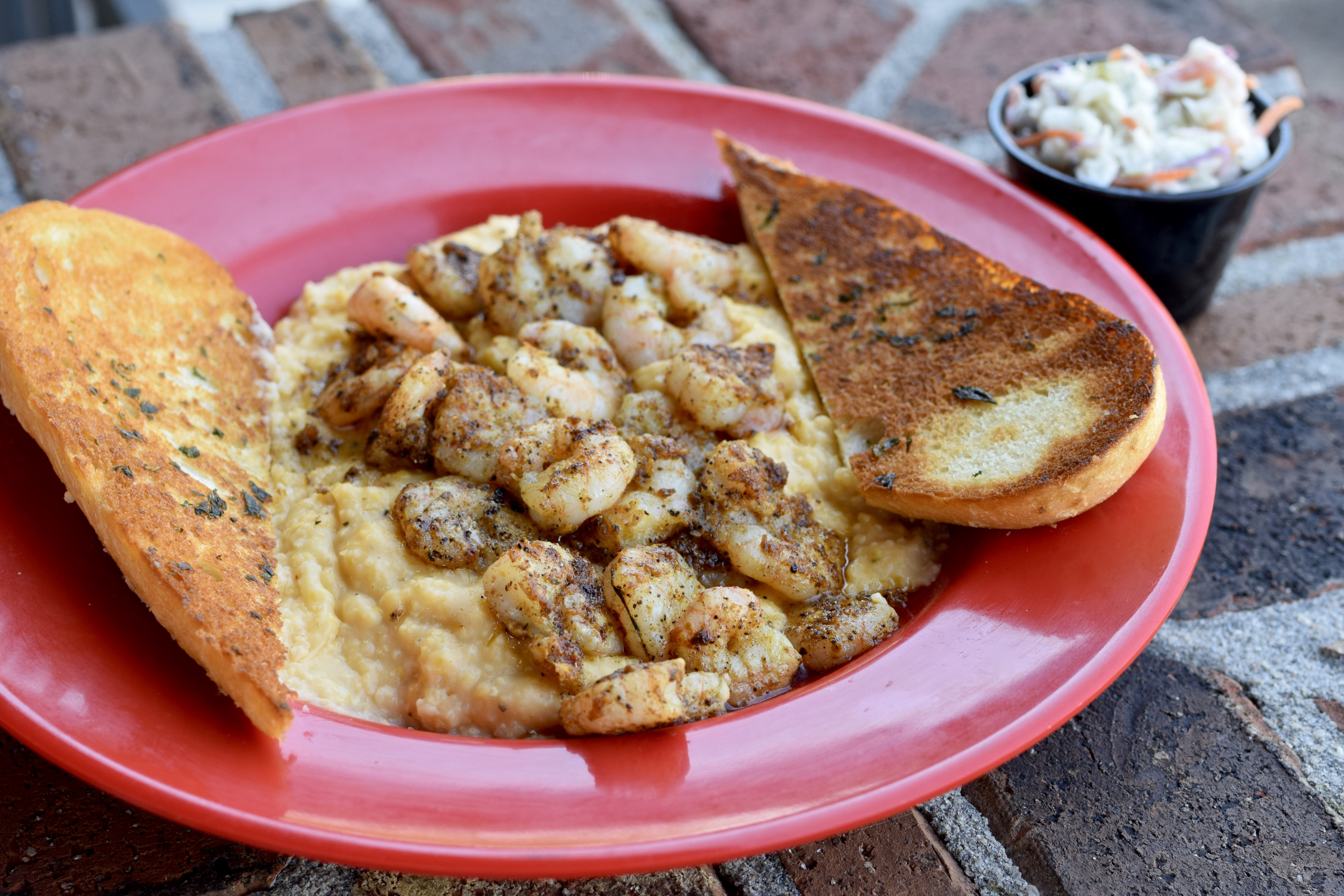 Classic shrimp and grits with a side of buttered toast
