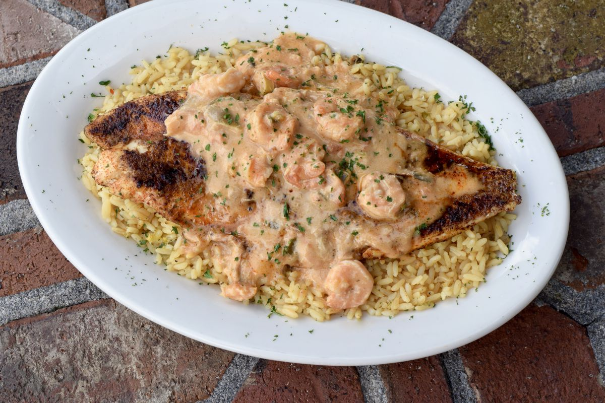 Redfish topped with Shrimp Ettoufee over rice
