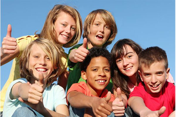 Image of a group of kids giving the thumbs up sign
