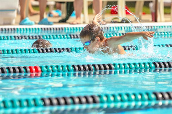 Image of a boy swimming in a swim meet