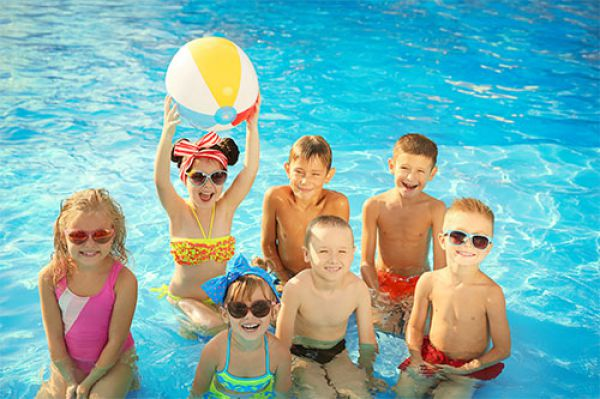 Image of a group of children swimming in a pool