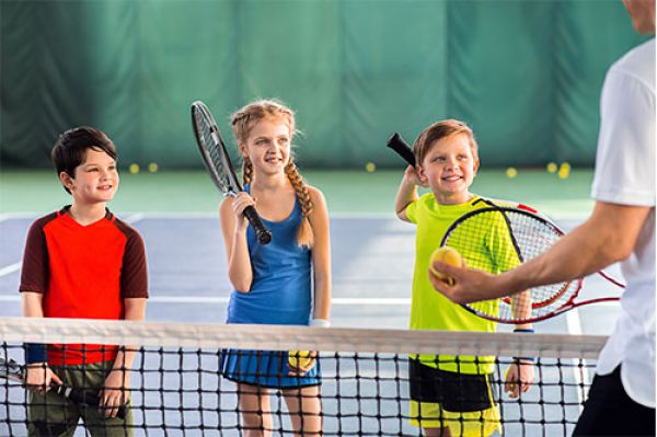 image of 3 kids learning to play tennis