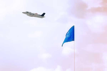 small plane flying over a blue flag at Augusta Municipal Golf Course