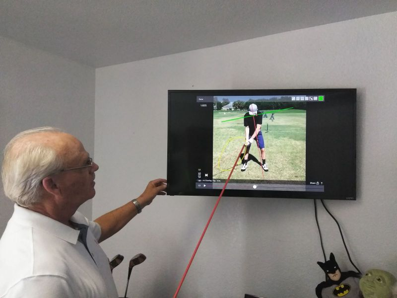 Rick Anderson pointing to a video on a monitor