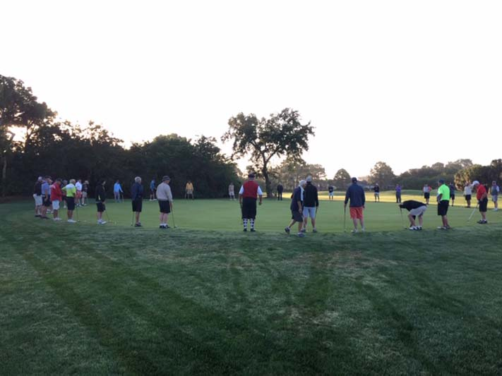 Golfers standing in a circle