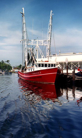 Classic red fishing boat tied up at dock