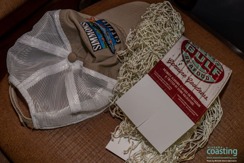 display table featuring netting and Simmons Catfish hat