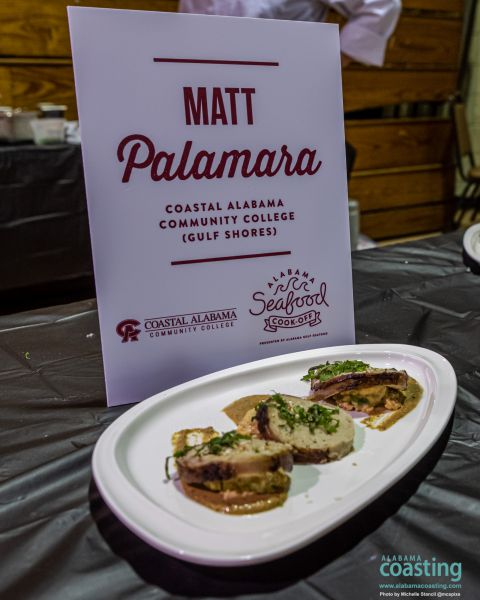 three toast points with toppings on dish in front of sign that says Matt Palamara