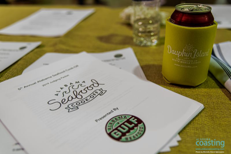 Close-up of event table with beer in coozie and paper menu