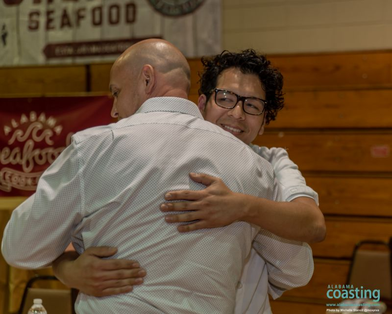two chef competitors hugging each other after winners announced