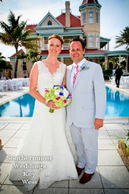 Wedding couple poses in front of the Southernmost Mansion in Key West Florida