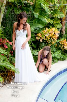Bride poses by the pool - Image by Southernmost Weddings Key West
