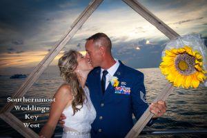 Wedding Couple poses for photos after the wedding on a spacious catamaran