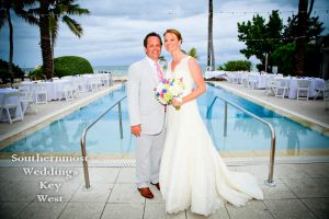 Wedding couple poses in front of the pool at the Southernmost Mansion in Key West Florida