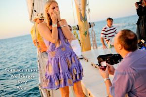 Surprise Engagement on a Sailboat by Southernmost Weddings Key West