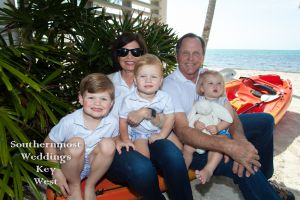 Grandparents sit with their Grand kids for family photos by Southernmost Weddings Key West