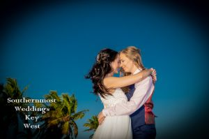 Lesbian Wedding Couple Kisses on Smathers Beach by Southernmost Weddings Key West