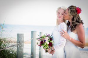 Lesbian Wedding Couple Kisses on the beach by Southernmost Weddings Key West