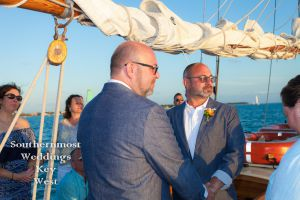 Gay Wedding Couple Exchange Vows on a Sailboat by Southernmost Weddings Key West