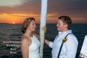 Lesbian Wedding Couple at Sunset on a Private Sailboat by Southernmost Weddings Key West
