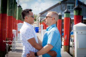 Gay Wedding Couple Embraces by Southernmost Weddings Key West