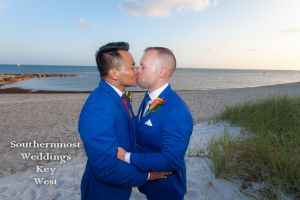 Gay Wedding Couple Kisses on the beach by Southernmost Weddings Key West